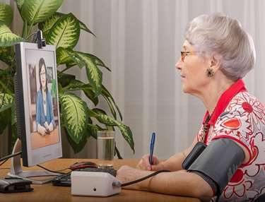 Older woman using telehealth services