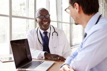 Meeting between a physician and a healthcare executive